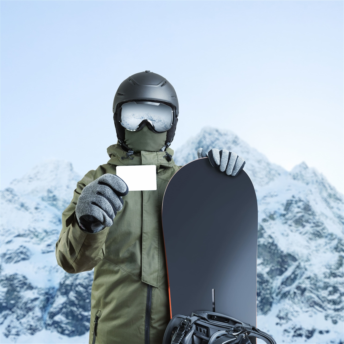 Skiier holding Ikon Pass - Deer Valley